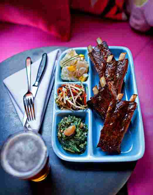 Barbecue ribs with potato salad, creamed spinach and cole slaw at  Jackie's Restaurant in Silver Spring, Maryland for The Washington Post Magazine