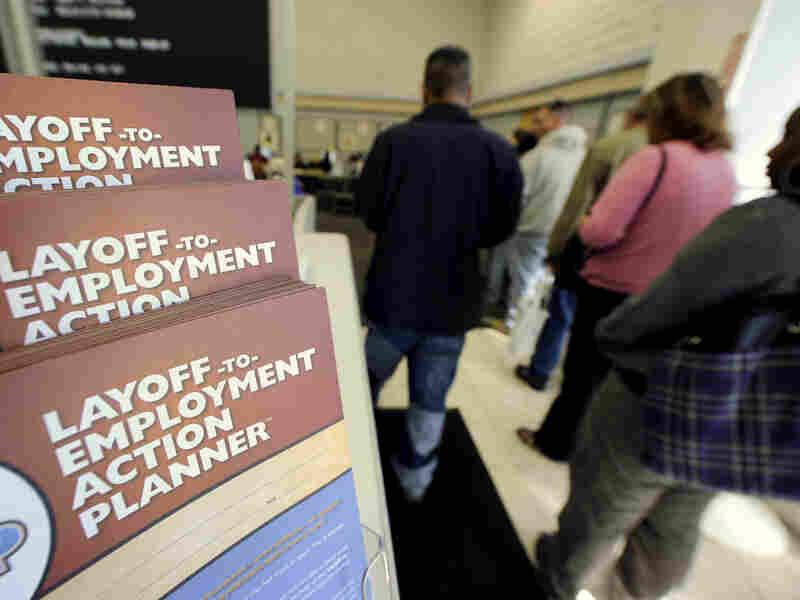 Job-seekers wait in line at a government-run employment center in Las Vegas.