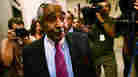 Charles Rangel surrounded by the media