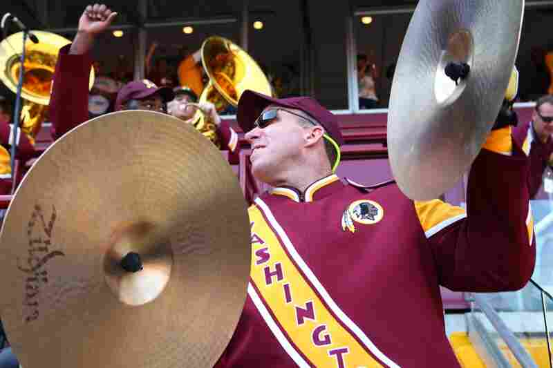 Founded in 1937, the band is one of only two pro football bands playing today. Here, Steve Richards whirls his cymbals while playing in the stands.