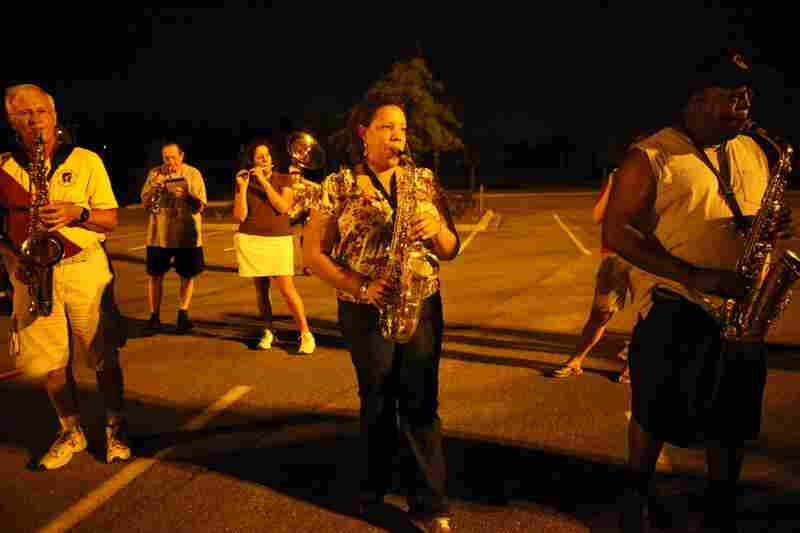 Dianna Washington plays alto sax during practice in the parking lot on Sept. 1. There are 126 musicians in the band; five or six new people join each year.