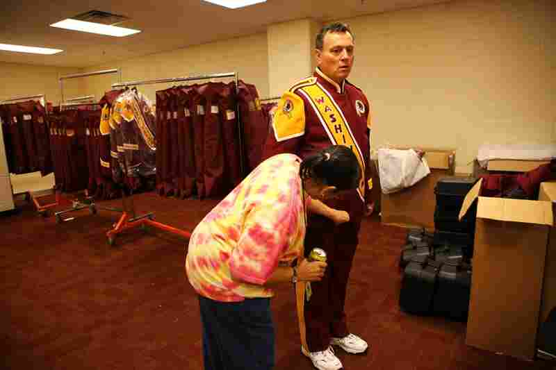 Kenneth Frye, a trumpet player from Burke, Va., gets fitted for his new band uniform with assistance from Barbara Robinson. The band received its first new uniforms in 25 years on Sept. 1 and debuted them at the Redskins' season-opening home game against the Dallas Cowboys on Sept. 12. This is Frye's 24th season with the band.