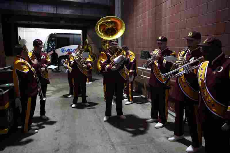 Warming up in the tunnel underneath FedEx Field before marching around the stadium prior to the game on Sept. 19.