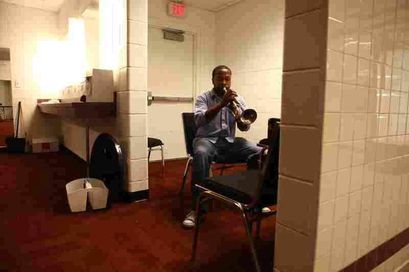 Larry Jenkins Jr., 24, from Forestville, Md., plays the trumpet during a successful audition for the band on Sept. 1. Jenkins teaches music theory at two Washington, D.C., public schools. The audition was held in the Redskins cheerleaders' locker room.