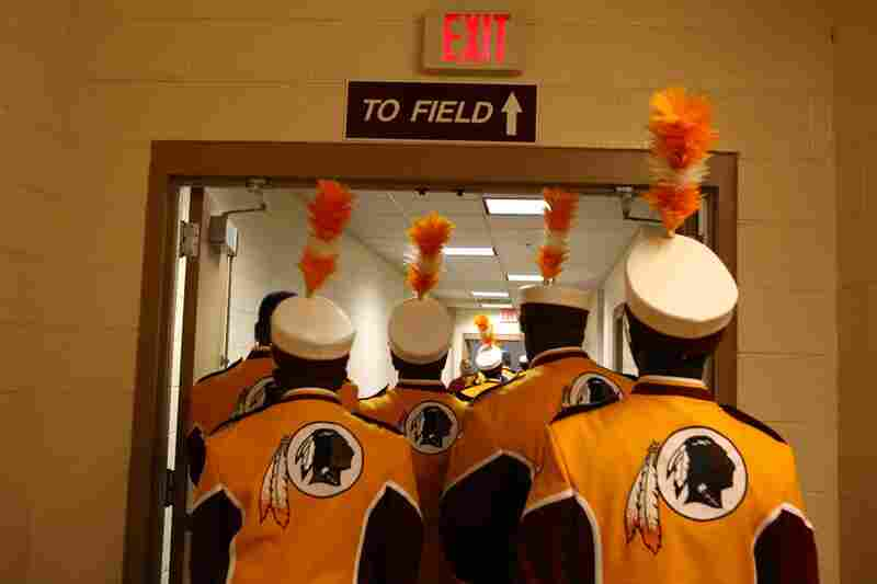 The band heads to the field before the pre-game show. The Baltimore Ravens are the only other pro football team with a marching band.