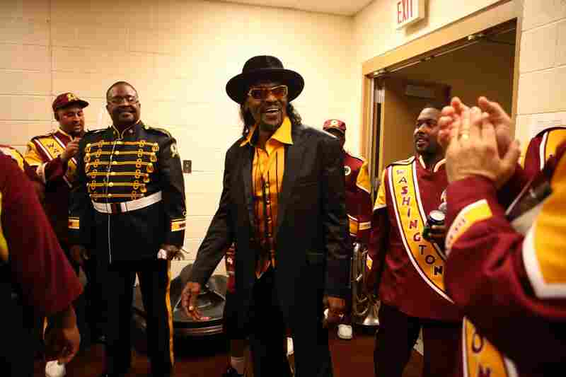 Go-go legend Chuck Brown stops by the band room before the game. Brown was playing the halftime show and the band members were elated at meeting him.