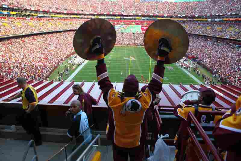 Steve Richards holds up his cymbals during the game against the Texans. The Redskins lost 30-27 in overtime.