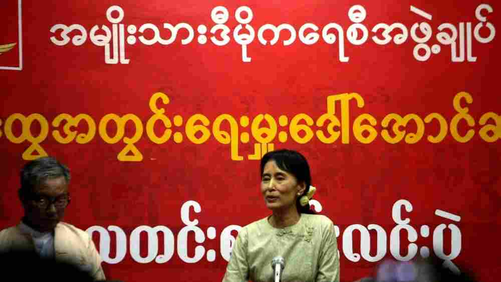 Aung San Suu Kyi addresses supporters at the National League for Democracy headquarters on November