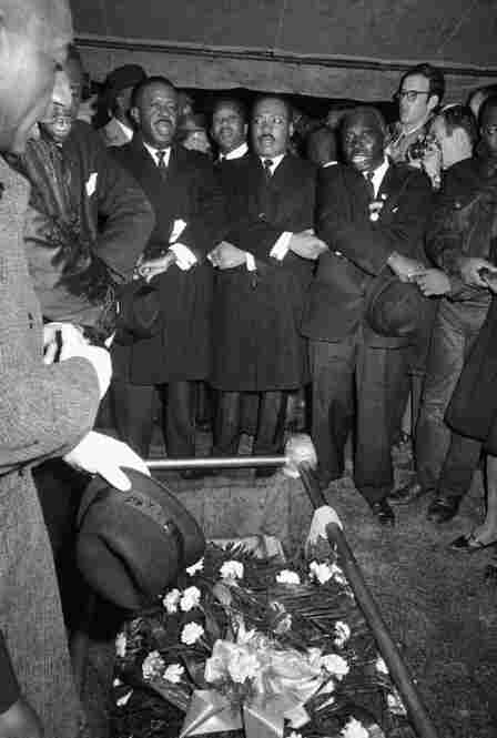 "King joins hands and sings ""We Shall Overcome"" as Jackson's casket is lowered into the gravesite. Just a few days after Jackson's funeral, civil rights activists marched from Selma to Montgomery, and the police brutality during that march, known as Bloody Sunday, ultimately led to the 1965 Voting Rights Act."