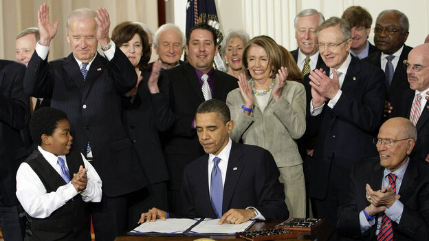 President Obama at the signing of the health care bill.