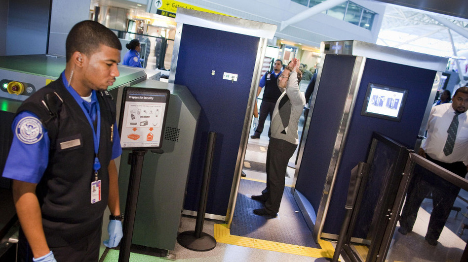 Transportation Security Administration officers give a demonstration of the first Advanced Imaging Technology unit at John F. Kennedy International Airport in New York City.  The new backscatter X-ray full-body scanners, which are optional, can see through clothing and will screen passengers for metallic and nonmetallic threats including explosives. (Getty Images)