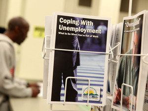 Pamphlets with information about unemployment are displayed in a career center in Oakland, Calif.