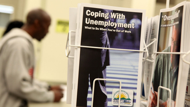 Pamphlets with information about unemployment are displayed in a career center in Oakland, Calif. (Getty Images North America)