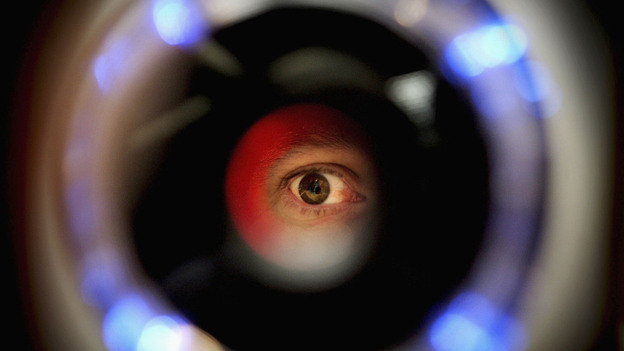 NYPD uses a handheld device to scan the iris. This is a picture of an iris recognition scanner featured in a biometrics exhibition. (Getty Images)