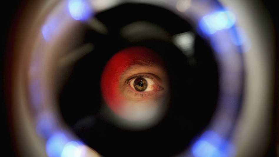 NYPD uses a handheld device to scan the iris. This is a picture of an iris recognition scanner featured in a biometrics exhibition.