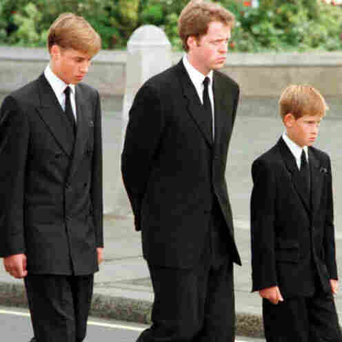Prince Charles walks with his family outside Westminister Abbey after Princess Diana's funeral.
