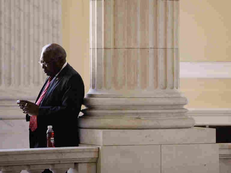 House Majority Whip James Clyburn looks at his BlackBerry during a break from a caucus meeting.