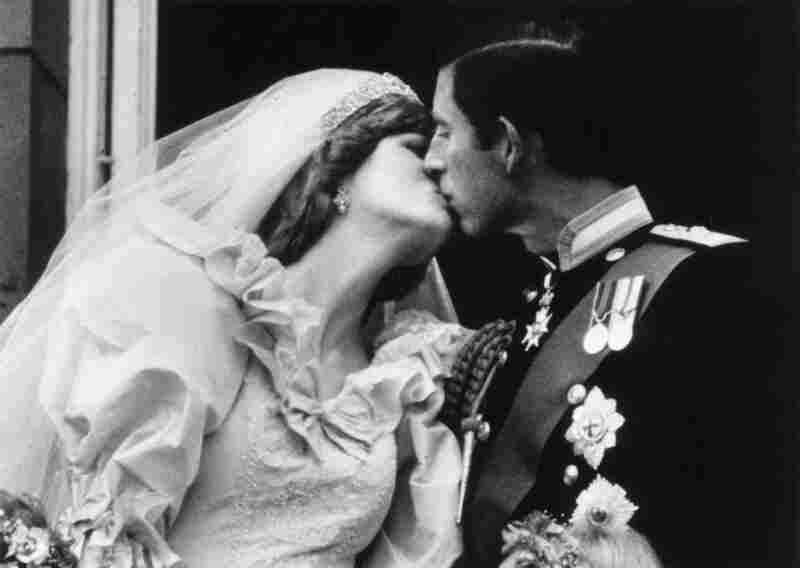 Prince Charles, the Prince of Wales kissing his wife, Princess Diana, on the balcony of Buckingham Palace after their marriage, July 29, 1981.