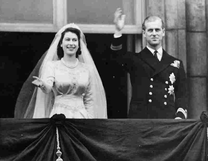 Princess Elizabeth, future Queen Elizabeth II, and Prince Philip, Duke of Edinburgh waving to a crowd from  the balcony of Buckingham Palace, London shortly after their wedding at Westminster Abbey, Nov. 20, 1947.