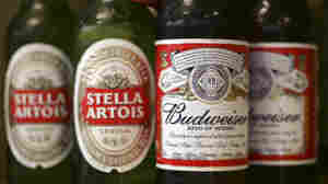 Bottles of Budweiser and Stella Artois beer are seen on display at Dixie Liquors in Washington