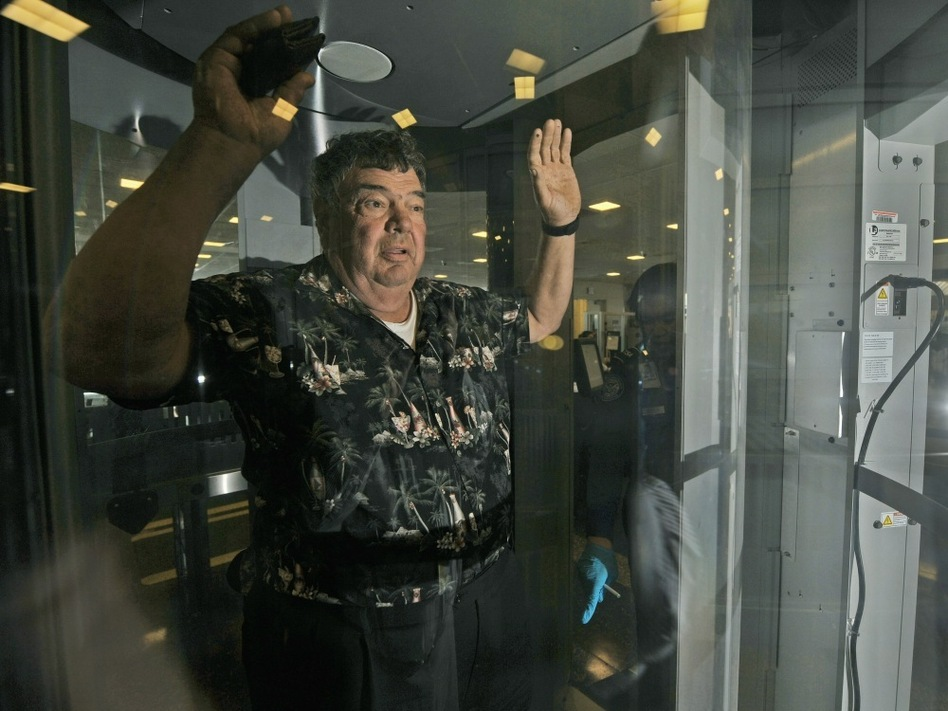 A passenger at Ronald  Reagan Washington  National Airport is subjected to a full-body scan. Passengers who don't want the scan are given invasive pat-downs. The measures have drawn criticism from civil liberties groups and airline pilots, but the head of the Transportation Safety Administration defended the measures before a Senate panel on Tuesday.