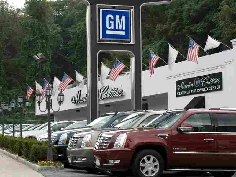 Cars are seen at a Cadillac dealer in Yonkers, N.Y., in 2009.