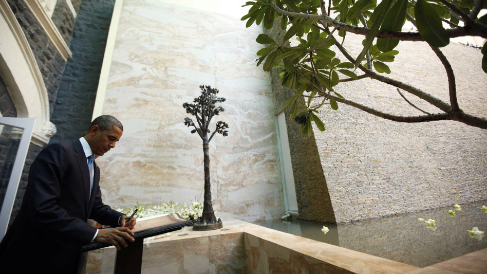 On his trip to India earlier this month, President Obama signs the guest book as he visits the memorial for the 2008 attack victims at the Taj Mahal Palace and Tower Hotel in Mumbai.