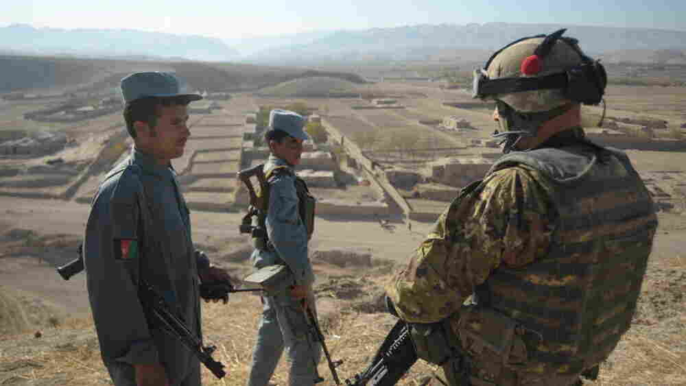 An Italian soldier (right) with Afghan army soldiers at  NATO's Combat Outpost Cavour.