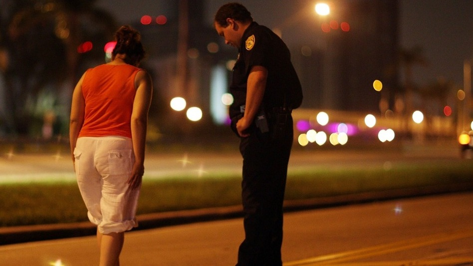 City of Miami police officer E. Dominguez conducts a field sobriety test in 2007. One approach to reducing traffic deaths that's common in Europe is frequent roadside sobriety checks, says Adrian Lund, president of the Insurance Institute for Highway Safety.