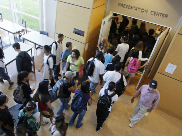 Students rush into a lecture hall at California State University East Bay (CSUEB) in Hayward, Calif. The California Supreme Court has ruled that illegal immigrant students who have attended high school in California for at least three years and graduated can continue to pay in-state tuition rates at public colleges and universities such as CSUEB.