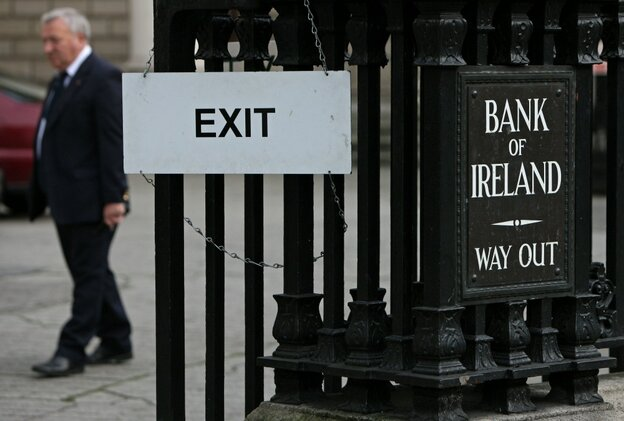 A man leaves the Bank of Ireland in Dublin, on November 15, 2010.