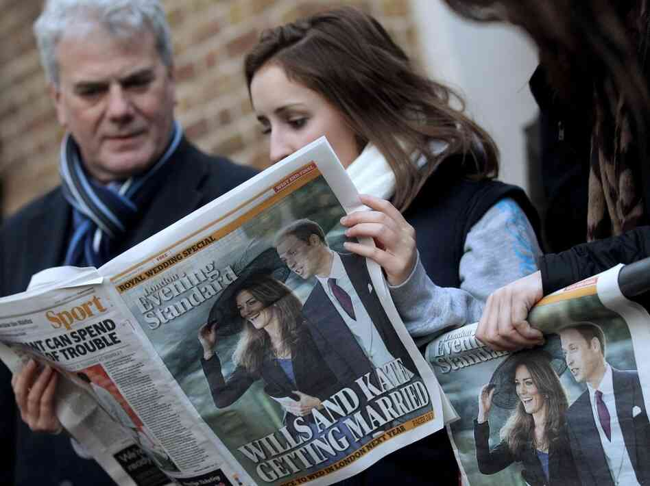 A woman reads a newspaper shortly after Prince William and Kate Middleton announced their eng