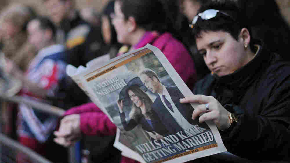 A woman in London reads a newspaper announcing Prince William's engagement to Kate Middleton.