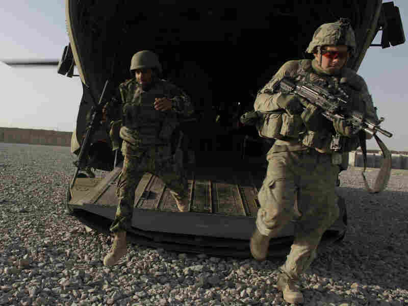 U.S. infantrymen from the 101st Airborne Division and Afghan army commandos