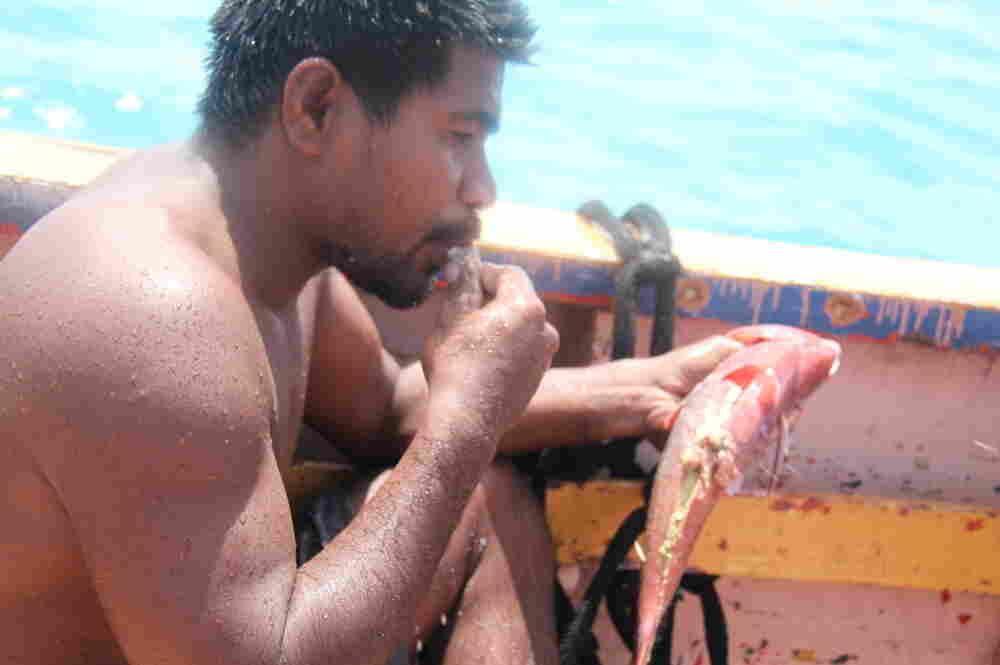 man catches fish