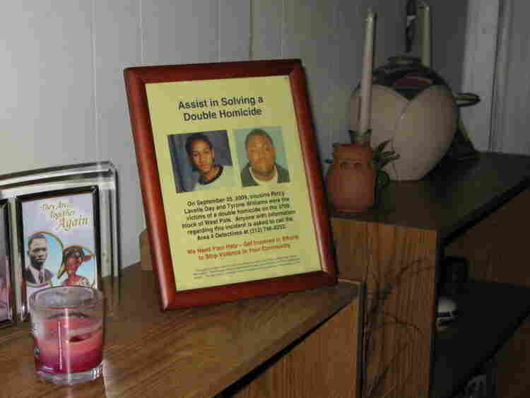 A framed flier with portraits of Percy Lavelle Day and Tyrone Williams