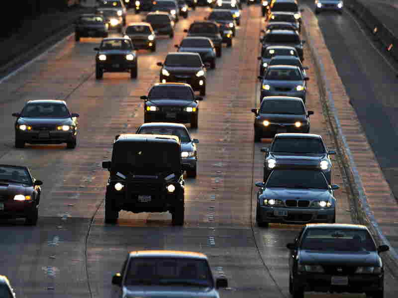 People drive on the Ventura Freeway at the end of the evening rush hour in Glendale, Calif.