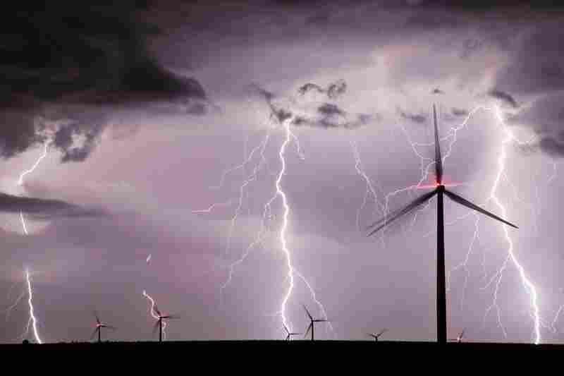 A thunderstorm over an Iowa's wind farm
