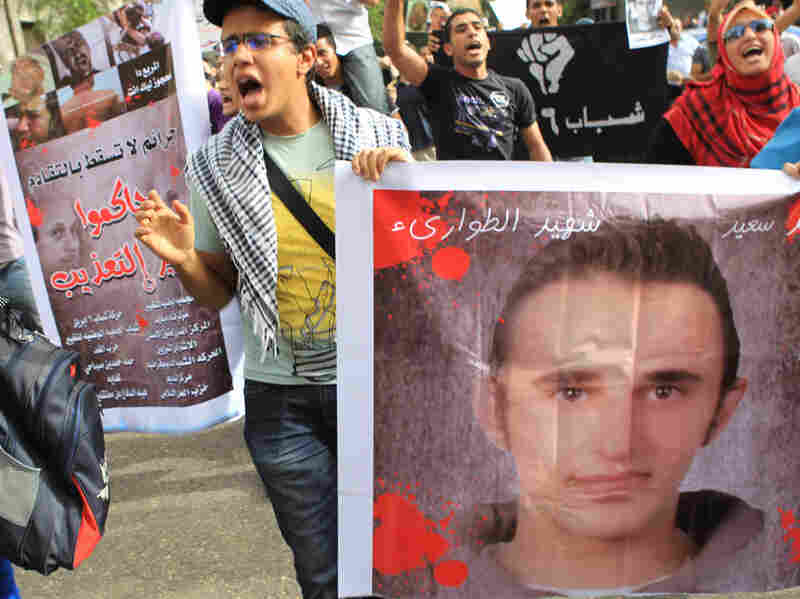 Egyptian youths demonstrate against the death of Khaled Said, allegedly at the hands of police