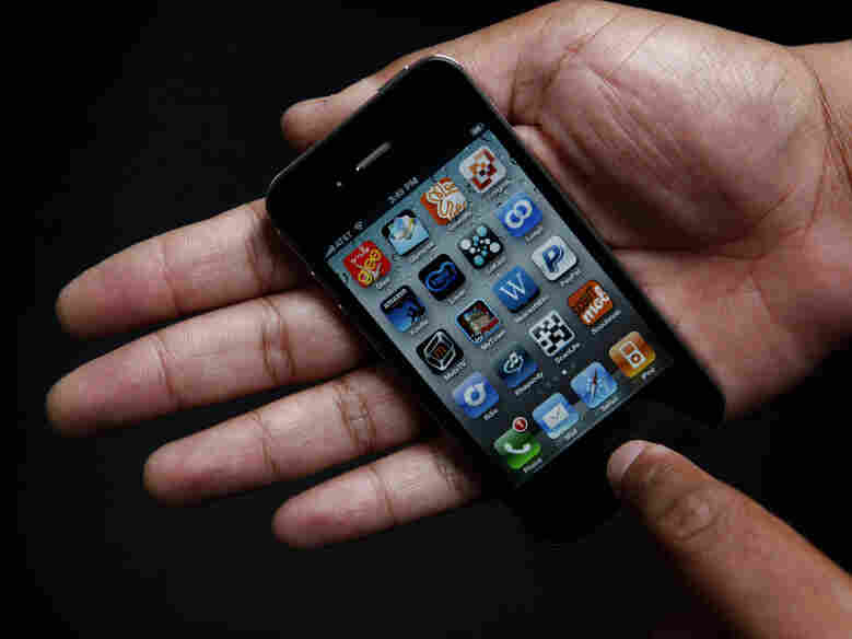 An iPhone in the palm of a hand.