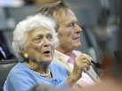 Barbara Bush and President George H.W. Bush at baseball game