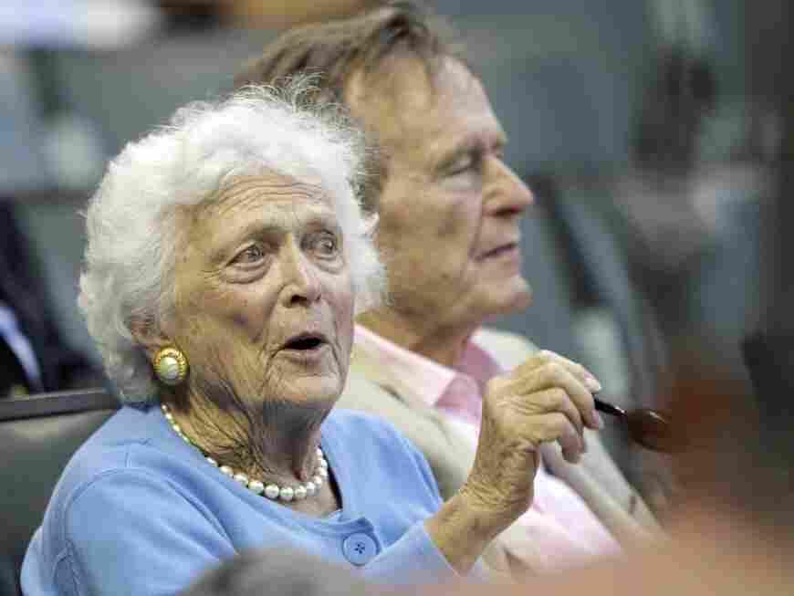 Barbara Bush and President George H.W. Bush at baseball game
