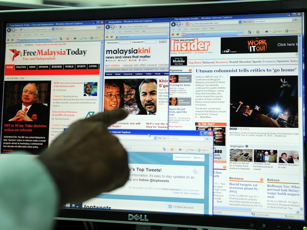A computer user in Kuala  Lumpur points to local news portals on the Internet.  Malaysia's government controls the  print media, but news is reportedly free online -- a factor that has altered the  balance of political power in the nation.