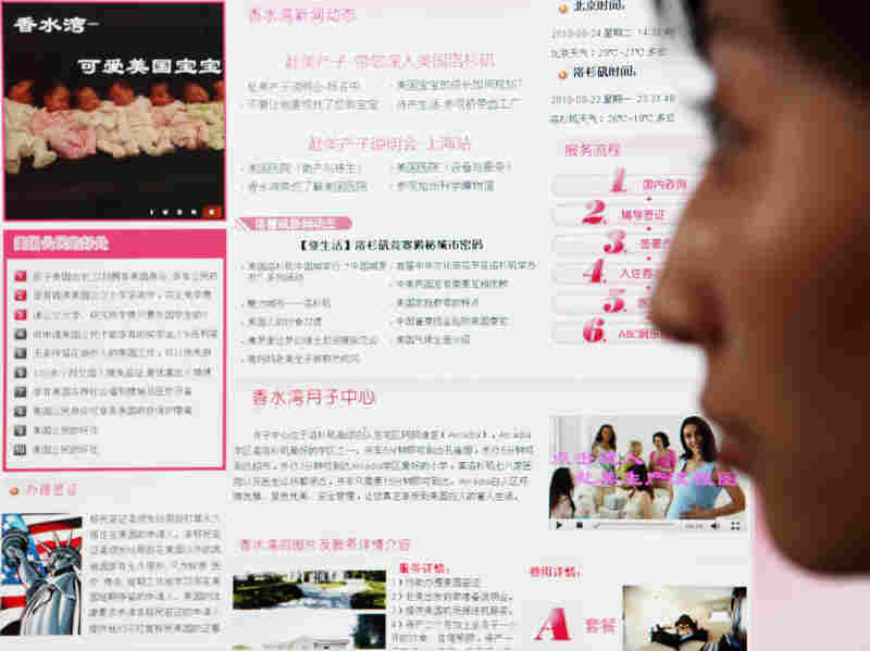 A Chinese woman browses the website of a birth tourism agency.