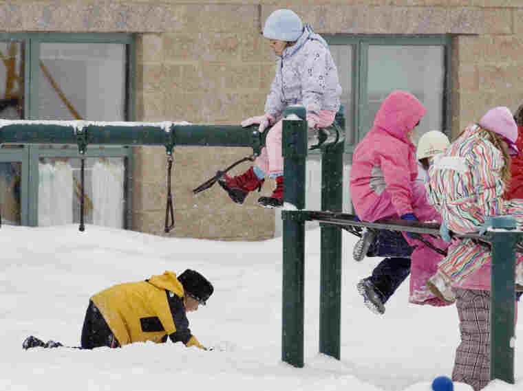 Students playing in the snow