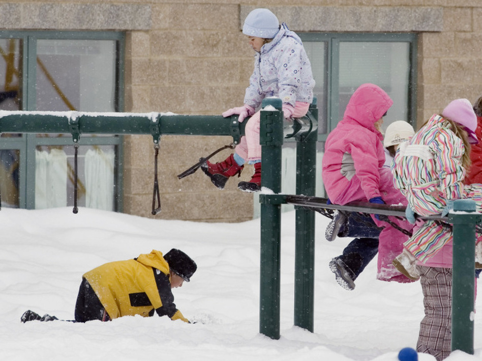 "Students play in the snow in Crested Butte, Colo. A school district in western Ohio is replacing ""snow days"" with ""e-days."" Now when school is closed for inclement weather, students will have to log on to their home computers to complete virtual lessons prepared by their teachers."