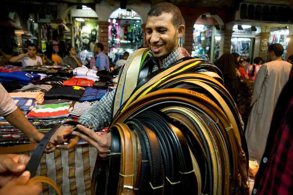 Despite its socialist roots, Egypt is now primarily a free-market economy with some state control. Here, a belt salesman carries his product around the market in the Ataba district of Cairo.