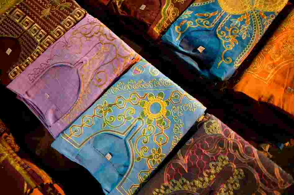 Embroidered shirts are available on the streets of the Ataba district. The black market is a concern to Egyptian businessmen doing business legally, as it cuts into their profits.