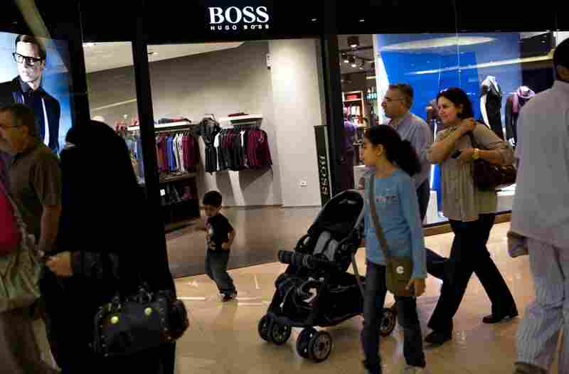 Shoppers walk past the Boss store at Citystars. In addition to upscale shopping, the Citystars complex also features three hotels, and residential and office towers.