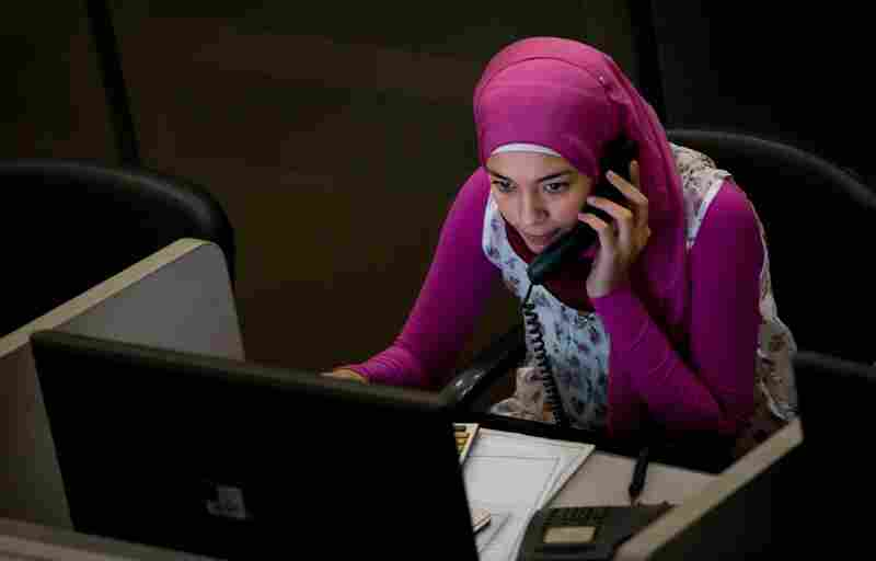 A woman works in her cubicle at the Egyptian Exchange in downtown Cairo. The exchange dates back more than 100 years — the Alexandria Stock Exchange was established in 1883, while the Cairo Stock Exchange was established in 1903. The two have since merged.